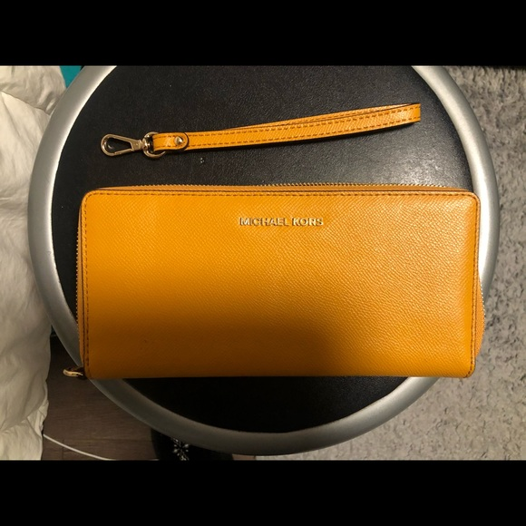 Michael Kors Handbags - Mustard Yellow Michael Kors wallet/wristlet